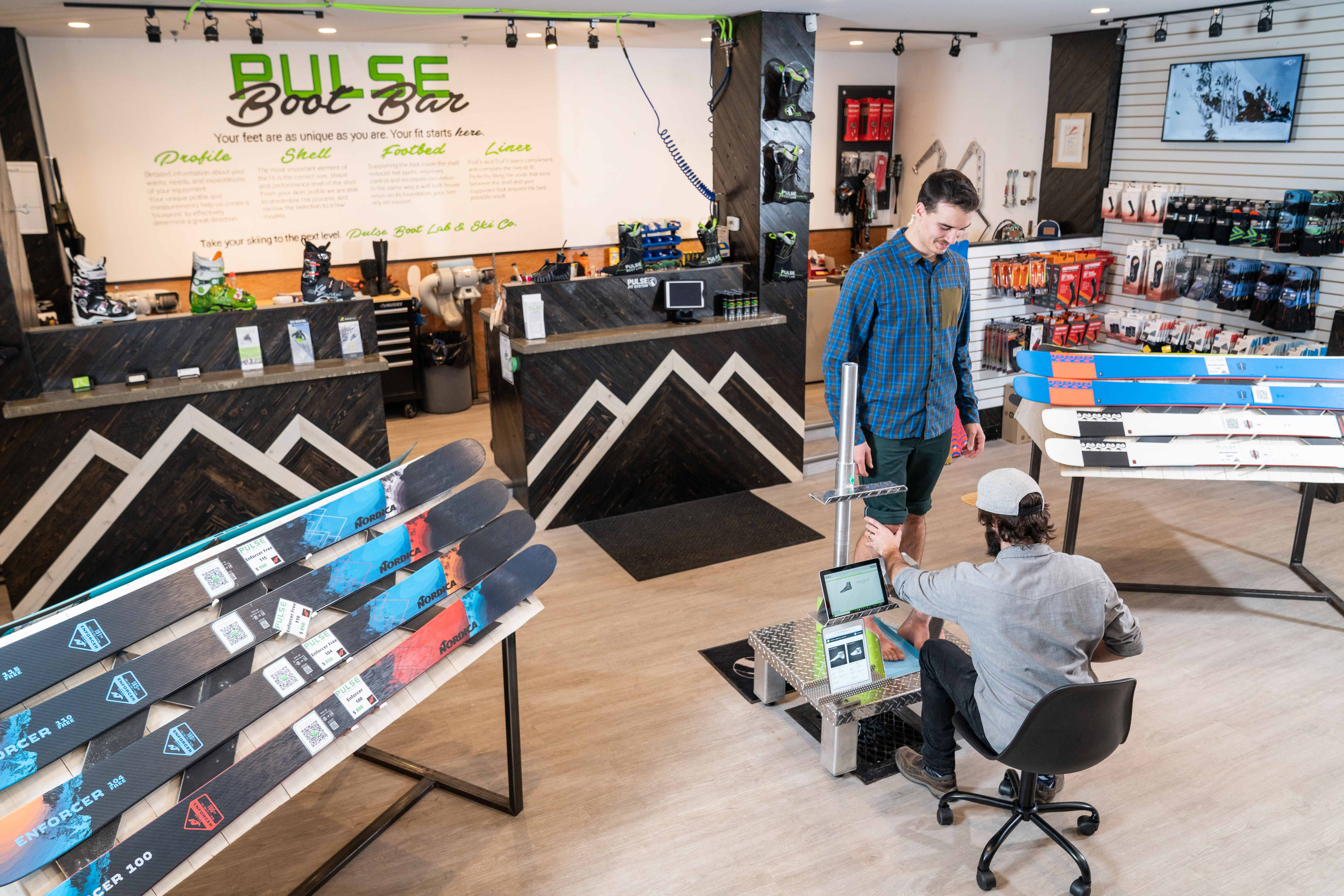 Image of customer receiving a boot fitting in store from a Pulse Boot employee